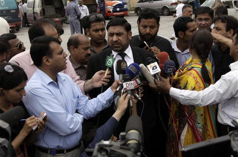 Prosecutor Chaudhry Zulfikar talks to journalists outside the anti-terrorism court (ATC) in Rawalpindi, in this file picture taken April 26,