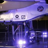 A man walks below the Solar Impulse aircraft at Moffett Field in Mountain View, California March 28, 2013. REUTERS/Robert Galbraith