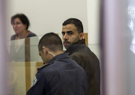 Hikmat Massarwa (R), a member of Israel's Arab minority, attends a remand hearing at the Central District Court in Lod, near Tel Aviv April