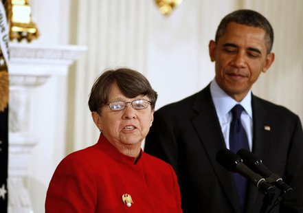 President Barack Obama (R) stands next to Mary Jo White, a former United States attorney, after he announces her to be the next chairwoman o
