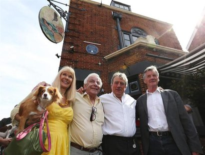 Monty Python's Flying Circus actors (L-R) Carol Cleveland, former colleague Barry Cryer, actor Terry Jones and Michael Palin pose outside th