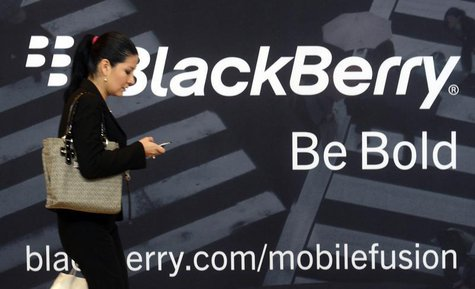 A woman uses her mobile phone at the Blackberry World Event in Orlando May 1, 2012. REUTERS/David Manning