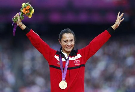 Gold medallist Turkey's Asli Cakir Alptekin smiles during the women's 1500 victory ceremony at the London 2012 Olympic Games at the Olympic
