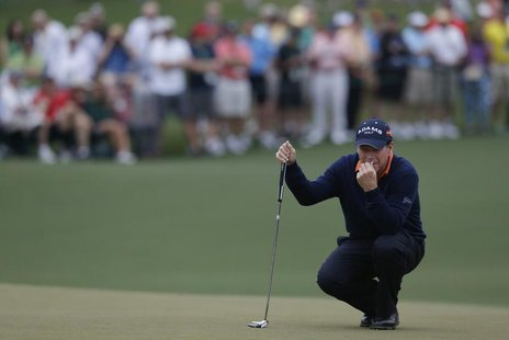 Former champion Tom Watson of the U.S. lines up a putt on the second green during first round play in the 2013 Masters golf tournament at th