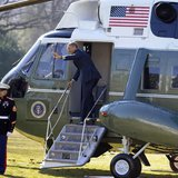 U.S. President Barack Obama waves to visitors as he steps aboard Marine One for departure from the White House, Washington February 14, 2013