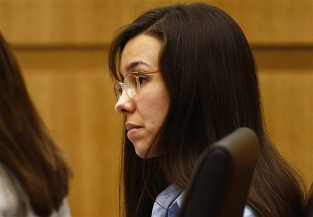 Defendant Jodi Arias listens as prosecutor Juan Martinez makes his closing arguments during her trial at Maricopa County Superior Court in P
