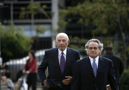 Former Milberg Weiss attorney Melvyn Weiss (L) arrives with his attorney Benjamin Brafman to plea in Weiss' case alleging his firm made illi