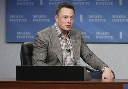 "CEO of Tesla Motors and SpaceX Elon Musk speaks during a session titled ""To Infinity and Beyond: Jeff Skoll talks with Elon And Kimbal Musk"""