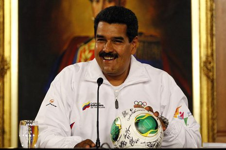 Venezuela's President Nicolas Maduro smiles during a news conference with Venezuela's Under-17 soccer team in Caracas April 30, 2013. REUTER