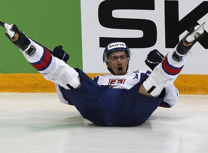 Slovakia's Miroslav Satan celebrates his scoring during their 2012 IIHF men's ice hockey World Championship semi-final game with Czech Repub