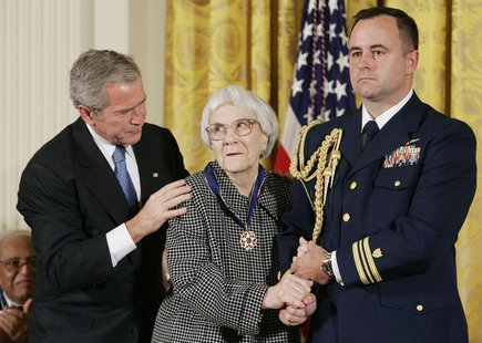 U.S. President George W. Bush (L) awards the Presidential Medal of Freedom to American novelist Harper Lee (C) in the East Room of the White