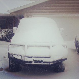 17 inches of snow helped hide this Toyota XJ after 5/1/13 snowstorm in Cameron, WI