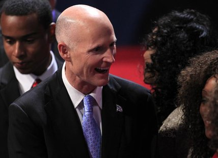 Florida Governor Rick Scott greets an attendee in the audience before the start of the final U.S. presidential debate between Republican pre
