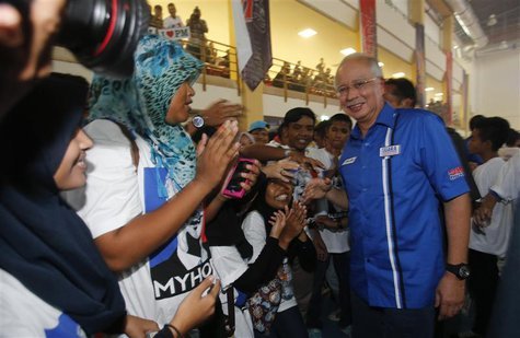 "Malaysia's Prime Minister Najib Razak (R) is greeted by youngsters after launching the ""Voices of My Generation"" youth programme in Kuala Lu"