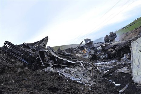 The wreckage of the Boeing KC-135 Stratotanker plane is seen at the site of its crash near the Kyrgyz village of Chaldovar, May 3, 2013. REU