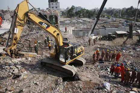 Rescue workers attempt to find survivors from the rubble of the collapsed Rana Plaza building in Savar, around 30 km (19 miles) outside Dhak