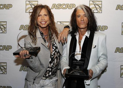 Steven Tyler (L) and Joe Perry of the group Aerosmith pose with the ASCAP Founders Award during a photo opportunity in Los Angeles April 8,