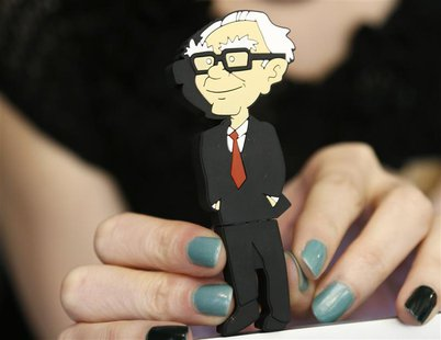 A Berkshire Hathaway souvenir USB memory stick cartoon figure of Berkshire Hathaway CEO Warren Buffett is for sale at a cocktail reception h
