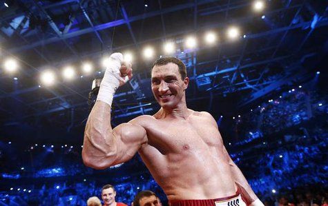 Heavyweight boxing World Champion Vladimir Klitschko of Ukraine celebrates after defeating his Italian-born challenger Francesco Pianeta at