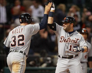 HEROES IN HOUSTON MEET: Detroit Tigers C Alex Avila (R) is congratulated by OF Don Kelly (L) after hitting a two-run homer in the ninth inning of Detroit's 4-3 victory over Houston at Houston's Minute Maid Park on May 3, 2013. Kelly singled home the go-ahead run in a 14-inning, 7-3 victory over the Astros the night before. (photo courtesy Detroit Tigers)