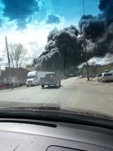 Smoke emerges from Cereal City Recycling, 6-1/2 Mile Rd.
