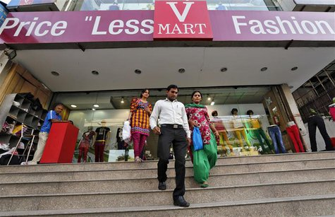 Customers exit a V-Mart retail store in New Delhi April 6, 2013. Picture taken April 6, 2013. REUTERS/Adnan Abidi