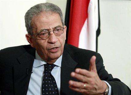 Opposition leader Amr Moussa, 76, a former Arab League secretary-general and Egyptian foreign minister, talks to Reuters during an interview