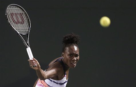 Venus Williams of the U.S. returns a shot to Kimiko Date-Krumm of Japan at the Sony Open tennis tournament in Key Biscayne, Florida March 21