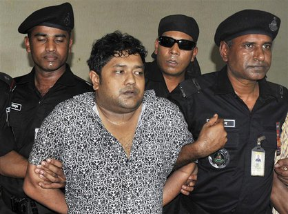 Members of the Rapid Action Battalion (RAB) present Mohammed Sohel Rana to the media after his arrest in Jessore, in Dhaka, in this file pic
