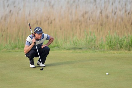 Brett Rumford of Australia lines his putt on the 17th hole during the Volvo China Open in Tianjin municipality, May 5, 2013. REUTERS/China D