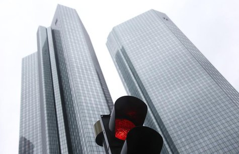 The headquarters of Germany's largest business bank, Deutsche Bank are seen behind a red traffic light in Frankfurt January 30, 2013. REUTER