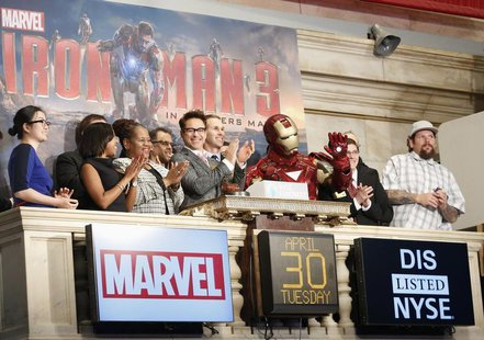 Actor Robert Downey Jr. (C) and Marvel Comics representatives ring the opening bell at the New York Stock Exchange to promote his new movie