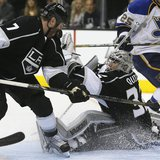 Los Angeles Kings' goaltender Jonathan Quick (R) makes a save as the Kings Rob Scuderi defends against the St. Louis Blues during Game 3 of