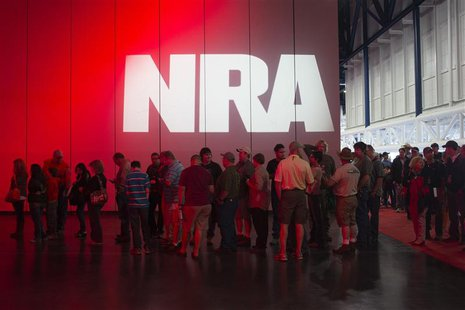 Attendees line-up to meet musician Ted Nugent (not pictured) at a book signing event during the National Rifle Association's annual meeting