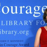 2013 John F. Kennedy Profile in Courage Award recipient, former U.S. congresswoman Gabrielle Giffords, listens as her husband Mark Kelly spe