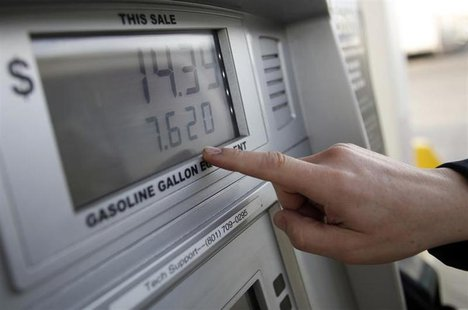 Thad Phillips notes the price for to fill his van with CNG at a Blu LNG filling station in Salt Lake City, Utah, March 13, 2013. REUTERS/Jim