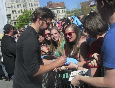 "John Krasinski, star of ""The Office,"" meets with fans during the ""'The Office' Wrap Party"" in Scranton, Pennsylvania on May 4, 2013. It was"
