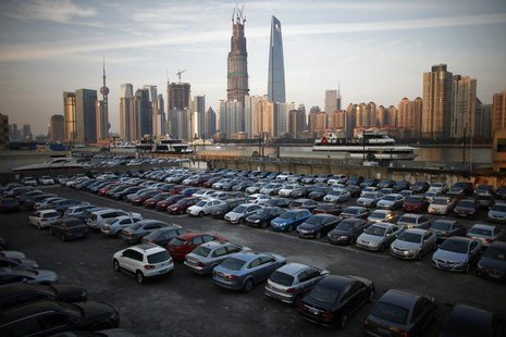A parking lot is seen along the Huangpu River near the financial district of Pudong in Shanghai December 12, 2012. REUTERS/Carlos Barria