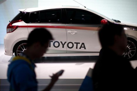 People look at a Toyota car during the 15th Shanghai International Automobile Industry Exhibition in Shanghai April 21, 2013. REUTERS/Carlos