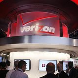 Showgowers visit the Verizon booth on the first day of the Consumer Electronics Show (CES) in Las Vegas January 8, 2013. REUTERS/Rick Wilkin