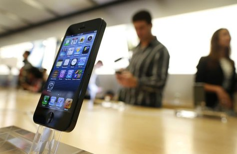 An iPhone 5 is displayed in an Apple store in central Sydney shortly after going on sale to the public September 21, 2012. REUTERS/Tim Wimbo