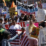 Demonstrators carry signs during an immigration rally on May Day in the Mission District in San Francisco, California May 1, 2013. REUTERS/R