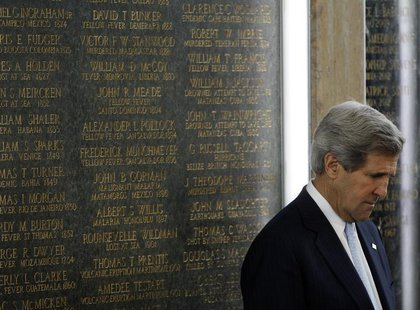 U.S. Secretary of State John Kerry reflects during dedication ceremonies at the State Department for new names inscribed on the American For