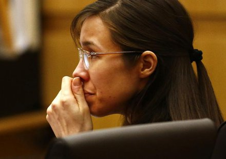 Defendant Jodi Arias listens to defense attorney Kirk Nurmi make his closing arguments during her trial at Maricopa County Superior Court in