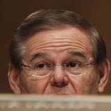 Senator Robert Menendez (D-NJ), a member of the Senate Banking, Housing and Urban Affairs Committee, asks questions during testimony in Wash