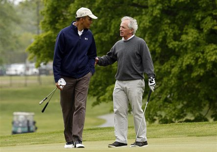 U.S. President Barack Obama and Senator Bob Corker (R-TN) talk during a round of golf at Joint Base Andrews in Maryland May 6, 2013. Senator