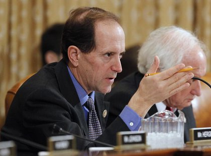 House Ways and Means Committee Chair Dave Camp (R-MI) questions U.S. Secretary of the Treasury Timothy Geithner in Washington February 15, 2