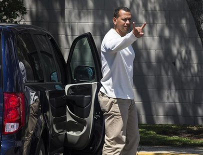 New York Yankees' Alex Rodriguez gestures as he arrives at the Yankees' minor league baseball complex in Tampa, Florida May 6, 2013. REUTERS