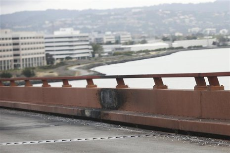 Burn marks left on the railing on San Mateo-Hayward Bridge are pictured on the morning after a fatal limousine fire in Foster City, Californ