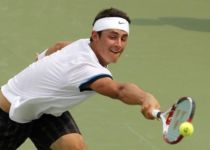 Bernard Tomic of Australia hits a return shot to Roger Federer of Switzerland during their third round match in the 2012 Cincinnati Open ten